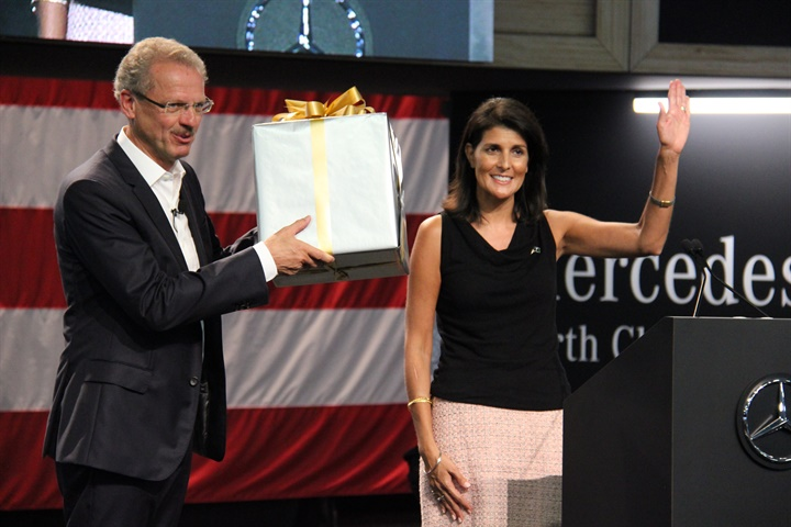 South Carolina Gov. Nikki Haley (right) presents a gift to Volker
