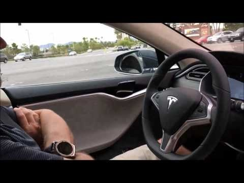 Still from a YouTube video of a Tesla S model owner using the vehicle