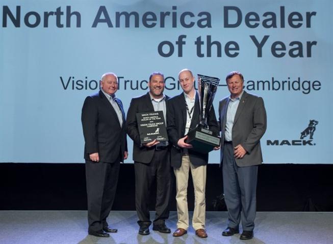John Slotegraaf, president of Vision Truck Group (center right),
