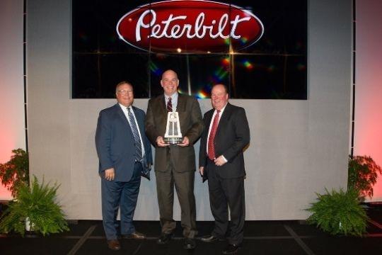 Doug Danylchuk, dealer principal of Peterbilt Manitoba, accepted the