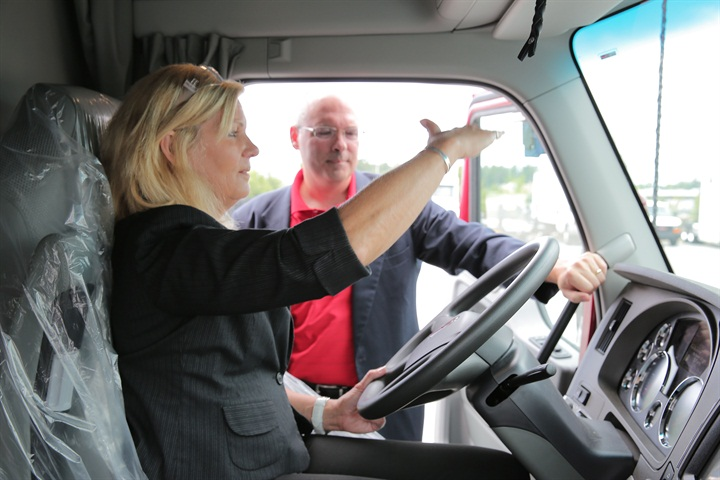 Ellen Voie, President and CEO of Women In Trucking, checking out new