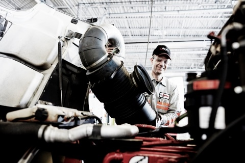 A Ryder technician performing a scheduled preventive maintenance