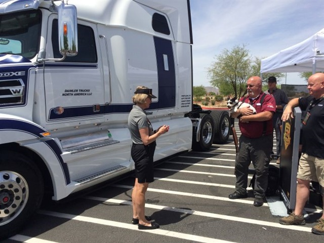 Western Star president Kelley Platt presents OOIDA spokesman Jon