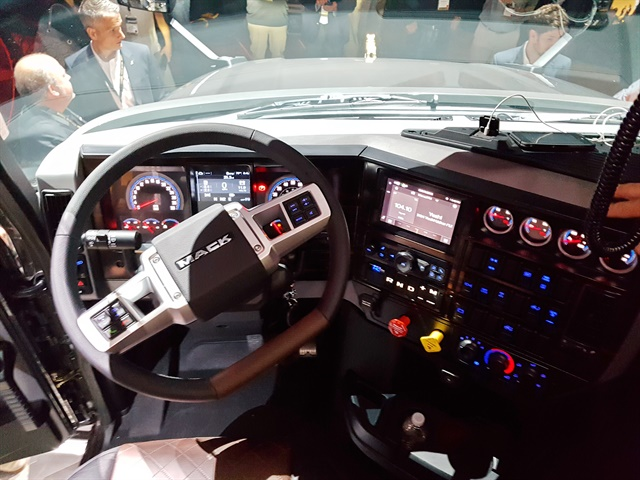 Inspired by racecar controls, a new flat-bottom steering wheel is a Class 8 trucking industry first, providing improved dash visibility, as well as easier ingress and egress. Photo: Jim Park