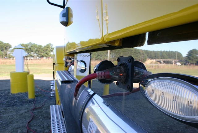 Truck drivers can access power through Shorepower Technologies pedestals.