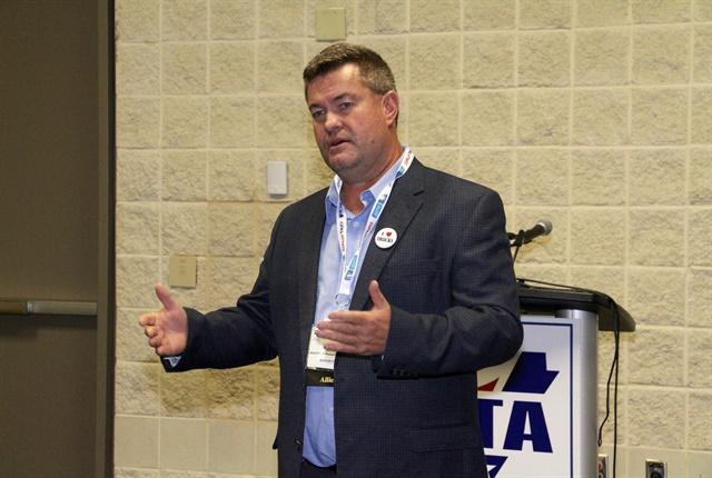 Acuity Insurance's Cliff Johnson talks trucking insurance to reporters. Photo: Evan Lockridge