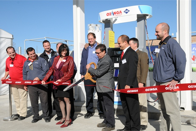 George Sakas, director of community and economic development for Des Plaines, cuts the ribbon. Photo: Jim Park