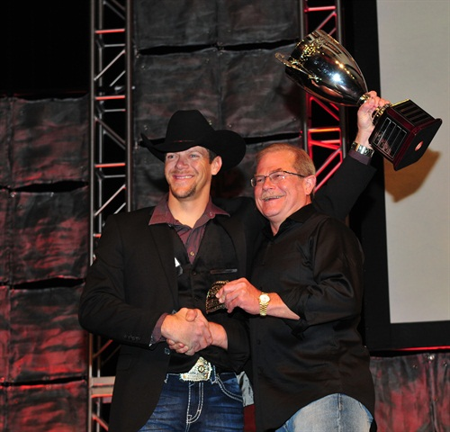 Dustin Ebert, left, accepts the Medium Duty Grand Champion trophy from Rush Enterprises CEO, Rusty Rush. Photo by Jim Park