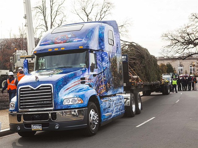 A Mack Pinnacle model delivers the 88-foot Christmas tree to the U.S. Capitol on a custom-built oversized trailer.