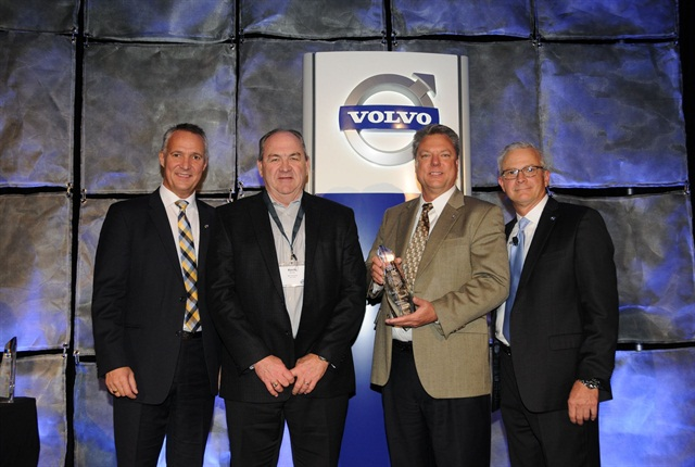 Chicago Truck owner Ron Meyering (second from right) and vice president Kevin Murtha (second from left) were awarded the 2014 Volvo Trucks North American Dealer of the Year award from (left) Göran Nyberg, president, Volvo Trucks North American Sales & Marketing and Terry Billings, Volvo Trucks vice president, business development (right).