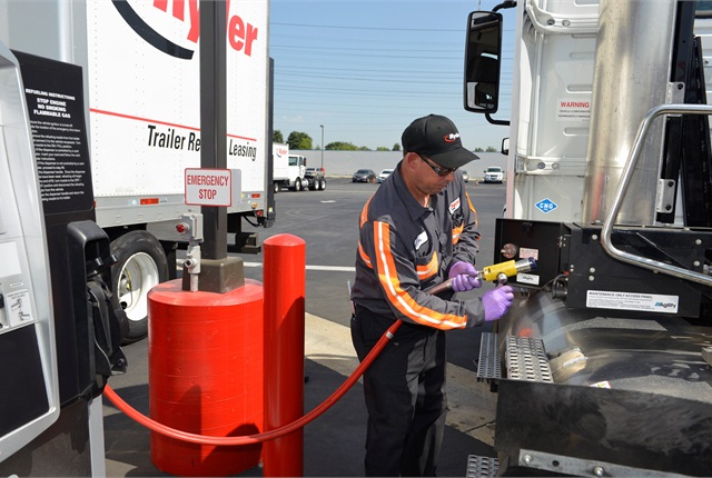 A Ryder technician fuels a CNG vehicle at Ryder's new natural gas fuel station in Fontana, Calif.