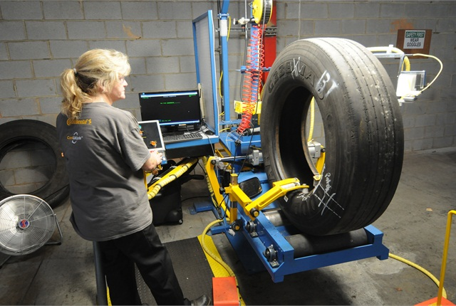 Dawn Watkins inspects a tire at newly opened DLS Retreading in Fort Mill, S.C.