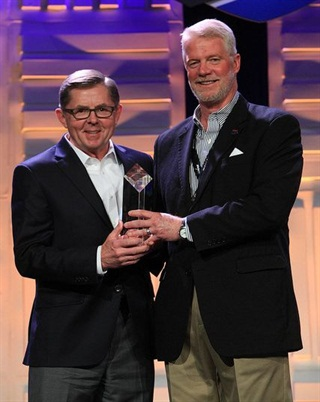 Dan England (left) recieving the award at the TCA Annual Convention. Photo: TCA