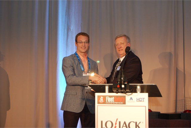 HDT Executive Editor David Cullen (right) presents Nussbaum Transportation's Jeremy Stickling with the inaugural HDT Safety and Compliance Award.