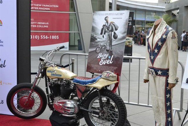 Knievel's iconic motorcycle and leather jumpsuit on the red carpet.