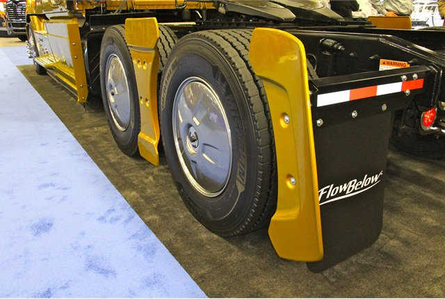 The FlowBelow AeroKit adorns a special gold Freightliner rig in the exhibit hall at ATA MC&E. Photo by Evan Lockridge.
