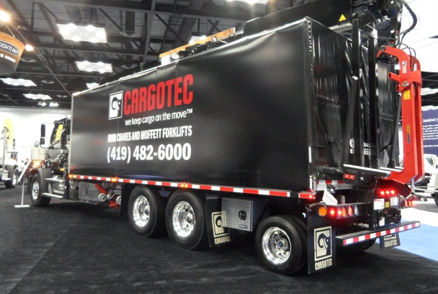 Close co-ordination between Cargotec and Freightliner eased the installation of a complex materials handling body with crane, forklift and tag axle on a 104SD chassis.