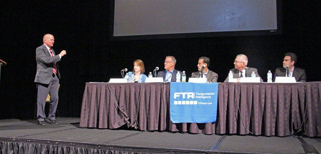 A panel discussion at the FTR Conference tackles the Amazon effect, with FTR's Eric Starks (left) moderating. Photo: Evan Lockridge