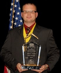 Derek Canard, of the Arkansas Hihgway Police, was awarded the Jimmy K. Ammons Grand Champion Award at NAIC 2013.