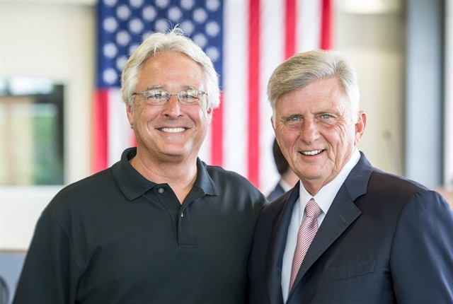 Arkansas Gov. Mike Beebe, right, was on hand for the grand opening celebration. Maverick Chairman and CEO Steve Williams is on the left. Photo courtesy Maverick Transportation