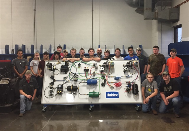 A class from teh Northalnd Career Center Diesel Technology Program poses with Haldex's donated air brake system board. Photo via Haldex