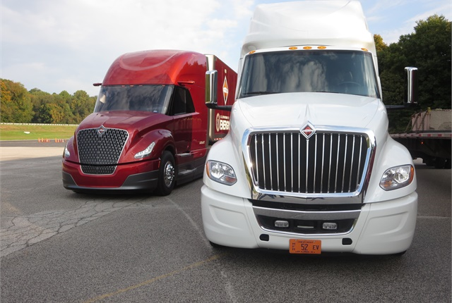 Nose of new LT tractor (right) resembles Navistar SuperTruck's (left). LT's hood slopes steeply downward.