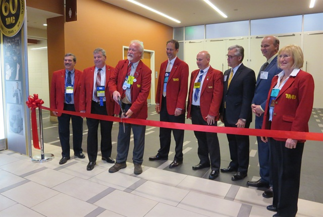 Kevin Tomlinson, outgoing TMC chairman, wields the scissors for the grand opening of the exhibit hall.