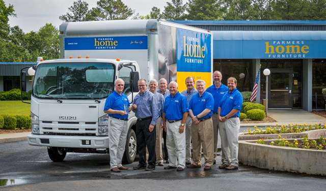 The 500,000th truck was sold to Famers Home Furniture in Dublin, Ga. Photo courtesy of Isuzu