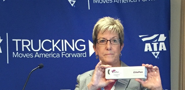 HELP Inc. President and CEO Karen Rasmussen shows off the new bypass-and-toll transponder. Photo: Deborah Lockridge