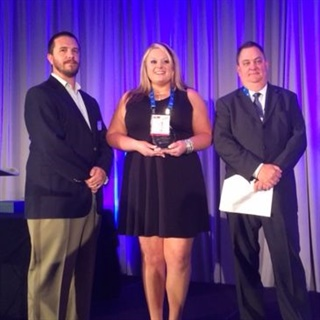 Rich Wilson, senior sales manager with Omnitracs (right) and Stephane Babcock, managing editor for Heavy Duty Trucking (left) present Kelsey Wolfe, Southern Freight Services' director of safety, human resources and recruiting, with the 2016 Safety & Compliance Award. Photo: Chris Wolski