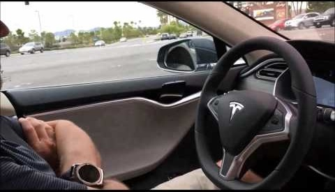 Still from a YouTube video of a Tesla S model owner using the vehicle's autopilot mode.