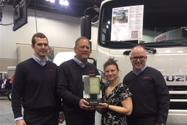 Work Truck's Executive Editor, Lauren Fletcher (second from right) presents the award to (l-r) ICTA's Tim Ellsworth, product planning manager; Shaun Skinner, president; and Brian Tabel, executive director, marketing. (Photo by Chris Brown)