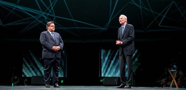 Michelin CEO Jean-Dominique Senard (right) welcomes attendees to Movin' On conference as Montreal Mayor Denis Coderre looks on. Photo: Michelin