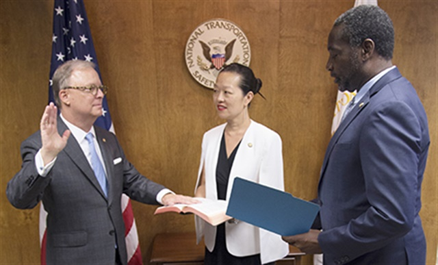 Robert L. Sumwalt III (left) sworn in as the National Transportation Safety Board's 14th Chairman during a brief ceremony held at NTSB headquarters on August 10, 2017. NTSB Board Member Bella T. Dinh-Zarr (center) NTSB Acting Managing Director Dennis Jones (right). Photo: NTSB