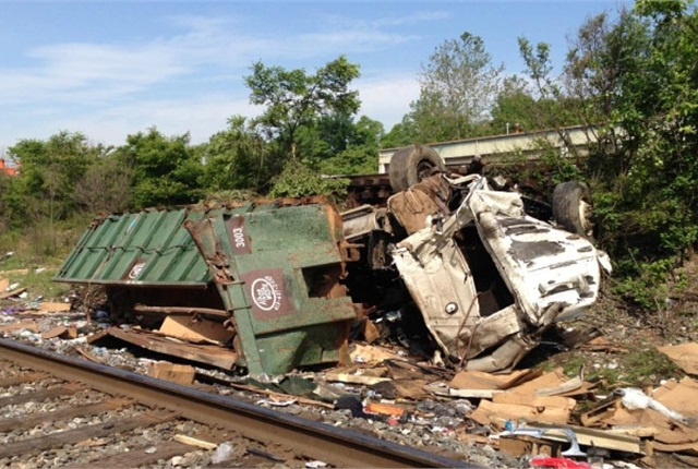 Driver of this trash truck said he didn't hear the train's horn, but investigators said he had just gotten a phone call and failed to stop, look and listen. Photo from the NTSB report.