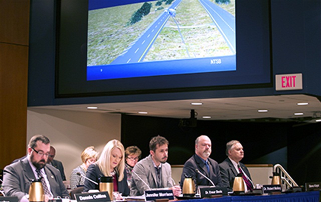 NTSB Investigator-in-Charge Jennifer Morrison shows the Board reenactment animation of collision between tractor-trailer truck and bus in Davis, Okla., on September 26, 2014. Photo: NTSB