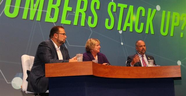 From left, Derek Leathers, Rebecca Brewster, and Bob Costello talk numbers at ATA. Photo: Evan Lockridge