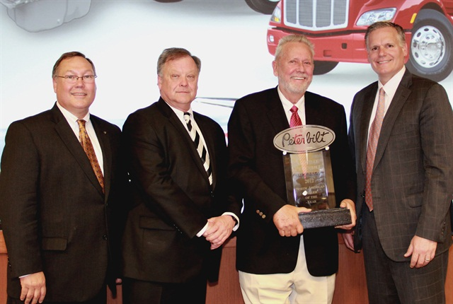 Peterbilt Motors Co. presents Allstate Peterbilt of Fargo the award for North American Dealer of the Year.