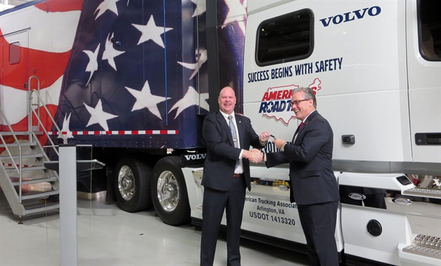 Volvo's Magnus Koeck, left, hands the keys to ATA's Pat Thomas. Photo by Deborah Lockridge