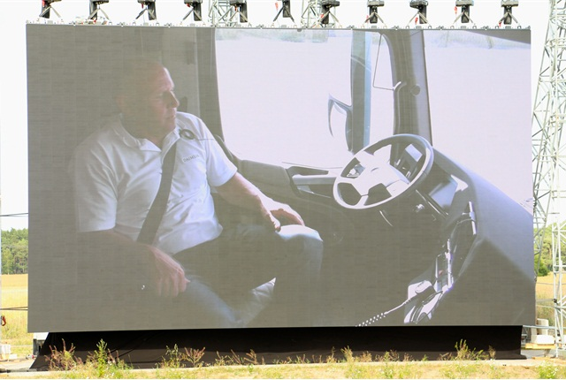 A view inside the cab of Future Truck 2025 while it is heading down the road during a demonstration, via a huge TV monitor at the event in Germany. Photo: Evan Lockridge