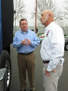 Greg Nauertz (right), a YRC local delivery driver from Phoenix and the first professional driver to act as a judge in the contest, gets a briefing on the natural-gas-powered Model 567 from Peterbilt's Charlie Cook. Photo by Tom Berg