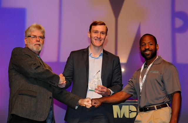 From left, Jim Park, awards committee chairman, presents the award to Josh Carter, Aperia's CEO, and Brandon Richardson, chief technology officer.