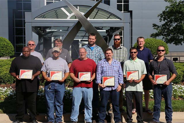 Proud winners pose outside U.S. Xpress headquarters in Chattanooga. All the competing techs got a tour of HQ and a chance to meet the top leadership. Photo: U.S. Xpress
