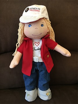 Clare is a female trucker doll designed by the Women in Trucking association. Photo: WIT