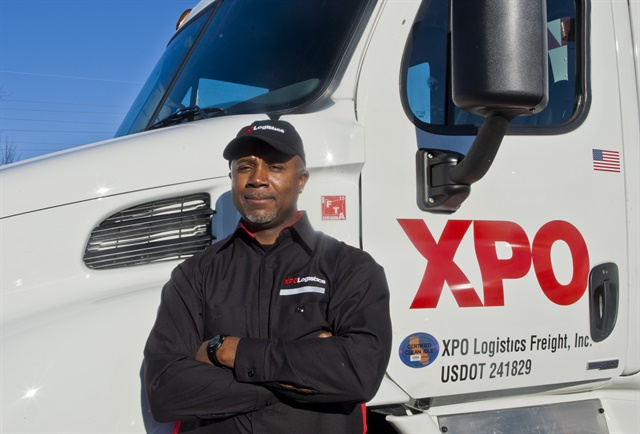 XPO LTL driver and truck show off the fleet's rebranded look. Photos: XPO Logistics