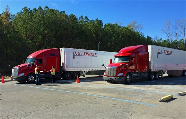 U.S. Xpress trucks preparing to begin a 52-mile fuel economy run out of its facility in Tunnel Hill, Georgia. The trucks are the latest model tractors available equipped with each OEM's most aggressive fuel economy package. Photo: Jack Roberts