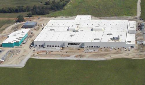 Construction of Paccar's new engine production facility in Columbus, Miss., continues on schedule. The technologically advanced and environmentally friendly facility will incorporate leading-edge manufacturing and diagnostic processes, says the company.