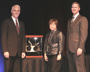 From left: Gary Moore, Kenworth general manager and Paccar vice president; Kari Rihm, president and CEO of award winner Rihm Kenworth; and Preston Feight, Kenworth assistant general manager, marketing and sales.