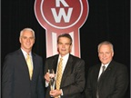 Truck Enterprises Hagerstown in Maryland was named Kenworth's 2013 Parts and Service Dealer of the Year for the U.S. and Canada at the recent Kenworth Dealer Meeting. From left are Gary Moore, Kenworth general manager and Paccar vice president; John Harter, president of Truck Enterprises Inc.; and David Danforth, Paccar Parts general manager.<br />