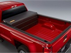 GM's bi-fuel option puts the CNG tank in a bed box. Gasoline